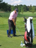 Former Master's Champion Trevor Immelman warms up on the range at Glen Abbey