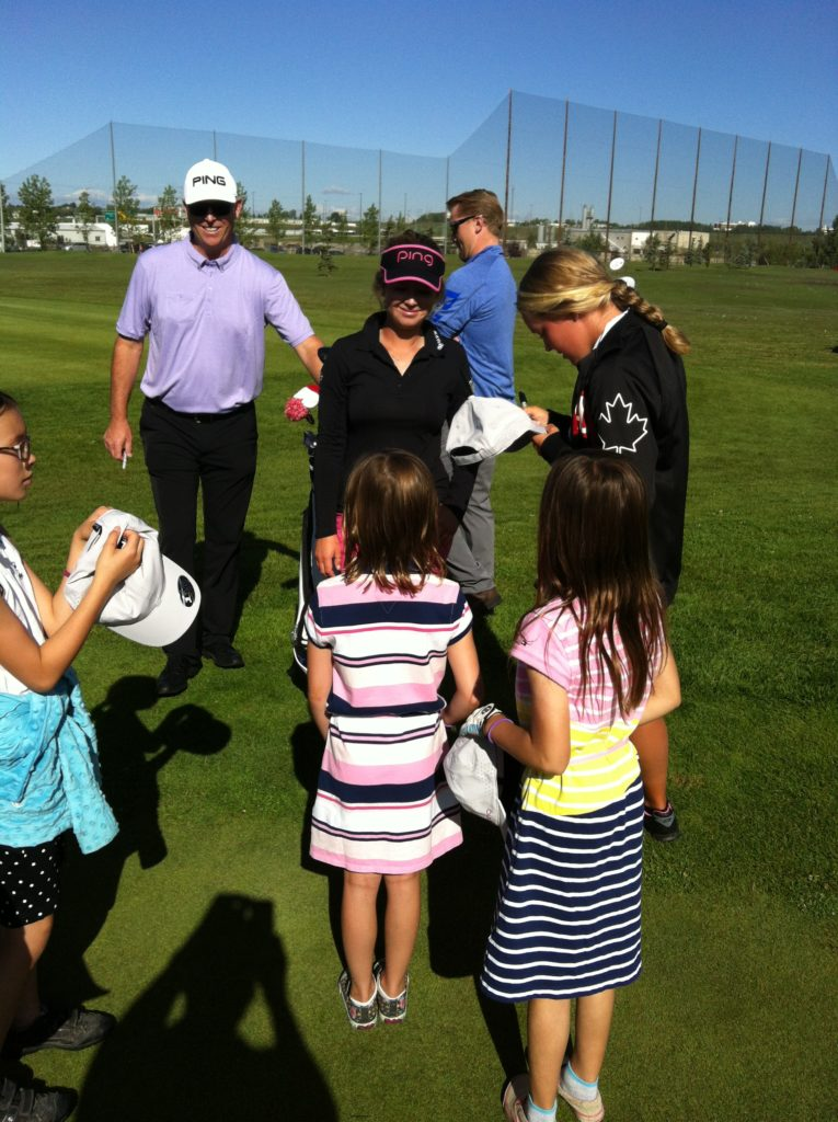 Autographs were the order of the day as Brooke signs a hat as Brittany and Dave Wilson from PING Canada look on