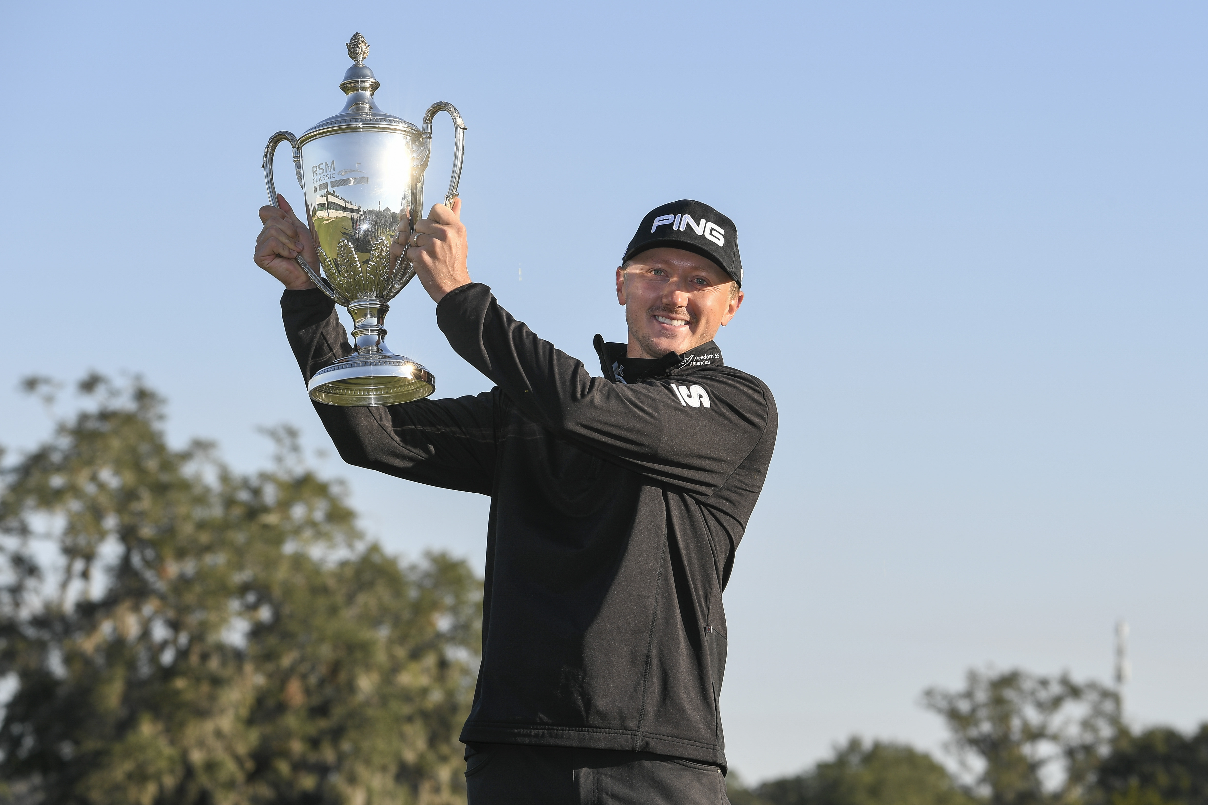 SEA ISLAND, GEORGIA - NOVEMBER 21: Mackenzie Hughes poses with the trophy following his victory in the playoff of the final round of The RSM Classic at Sea Island Resort Seaside Course on November 21, 2016 in Sea Island, Georgia. (Photo by Ryan Young/PGA TOUR)